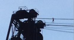 Benjamin Lovitz tightrope walking the Steel Bridge, Portland, OR
