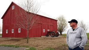a-man-walks-into-a-barn